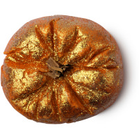 A orange bubble bar in the sahpe of a pumpkin convered in glitter
