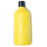 Gel doccia nudo a forma di bottiglia di colore giallo con tappo di nero di cera.