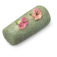 a green cleanser made from sugar with fresh flowers on top