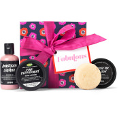 a pink, black and red gift set with red ribbon and array of lush products