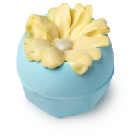 blue bath bomb with cream coloured lotus flower on top
