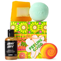 orange green and yellow gift box with products around it
