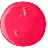 Um circulo vermelho do gel para duche Prince Charming com sumo fresco de romã