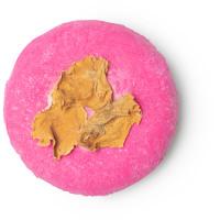coconut rice cake champú sólido de color rosa con flores amarilla y con coco