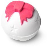 bomba de baño de color blanco en forma de campana navideña con un moño rosa
