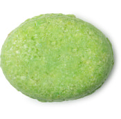 an oval green solid conditioner bar