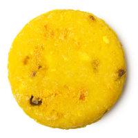 Yellow, round solid shampoo bar