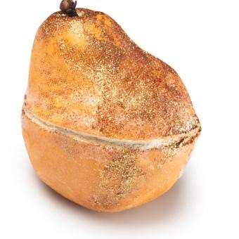Eine goldene Seife in Form einer Birne