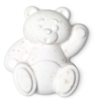 eine weiße badebombe in der form eines winkenden bären