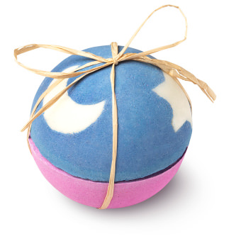 a giant bath bomb with stars and ribbon