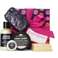 dark purple box with pink flower pattern on it surrounded by products
