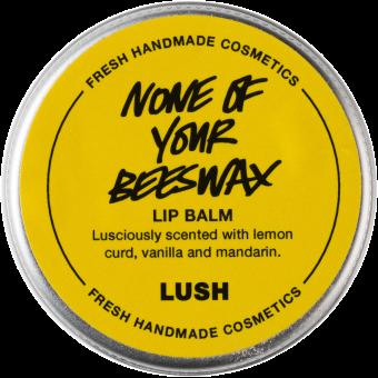 Vista dall'alto della confezione del Balsamo labbra vegan a base di olio di cocco e agrumi per labbra screpolate e secche None of Your Beeswax