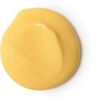 Gelber Haarconditioner in einer Flasche aus recycletem Plastik