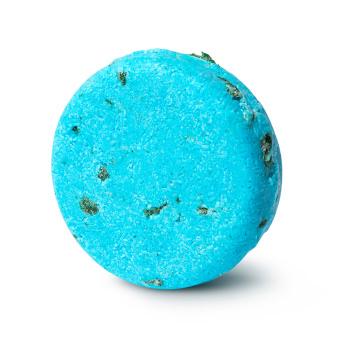A round, bright blue shampoo bar with green seaweed specks