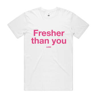 A white t-shirt with Fresher Than You written in pink on the front. the Lush logo is below the text, smaller and also in pink