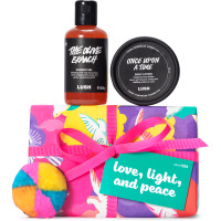 Purple, pink and yellow present with dove print on it surrounded by products