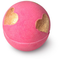 pink bath bomb with golden stars in it