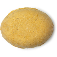 an oval shaped golden conditioner bar