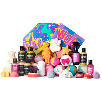 multicoloured purple gift box with products in front of it