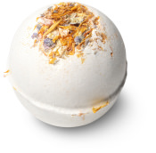white bath bomb with petals on top