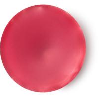 Una azucarada fragancia floral de color rojo en formato sólido para llevar de viaje