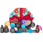 light blue lush life gift box with products surrounding it and a red ribbon