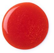 Um circulo vermelho do gel  Hot Toddy para o duche
