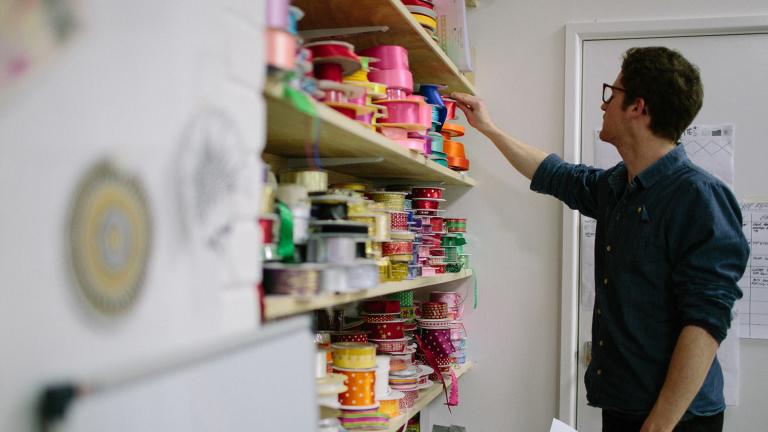 Gift designer at lush choosing ribbon