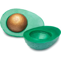 green avocado shaped soap with glittery golden centre that looks like an avocado seed