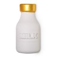 Milky Bath spumante da bagno riutilizzabile a forma di bottiglia di colore bianco con tappo oro da porre sotto il getto d'acqua del rubinetto della vasca per fare bagni pieni di schiuma LUSH