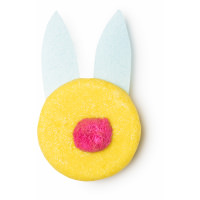 A yellow shampoo bar with pink ears