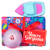 blue, pink and green floral themed gift box with products around it