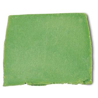 un bloque de color verde del champú sólido avocado co wash