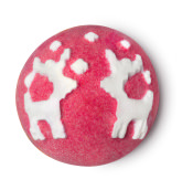 A red bath bomb with white reindeers patterns on the top