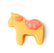 yellow and orange bath oil in the shape of a horse on a white background