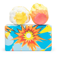 blue and orange patterned present with bath bombs on top on white background