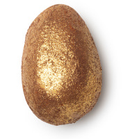egg shaped bath bomb covered in gold glitter