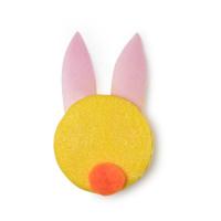 Ein gelbes festes Shampoo mit pinken Häschen-Ohren