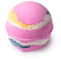 pink bath bomb with white yellow and blue strips around it