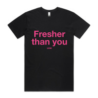 A black tshirt with Fresher Than You written in pink on the front. the LUsh logo is below the text, smaller and also in pink