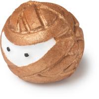 ginger ninja é uma bomba de banho de cor bronze com um rosto de um ninja