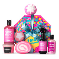 Pink gift with snow fairy products surrounding it