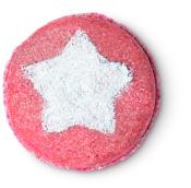 pinker runder shampoo bar mit weißem stern in der mitte
