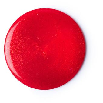 circular blob of red shower gel with golden shimmer