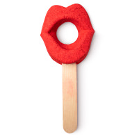 red lips shaped bubble bar on a stick with hole through the middle