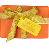 A orange gift box wrapped in a yellow and silver ribbon as seen from the front