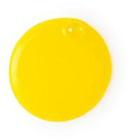 calacas gel de ducha revitalizante con aceite de lima y de color amarillo vibrante