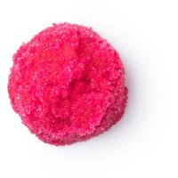 Ein rotes Lippenpeeling in einem Glastiegel