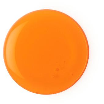 a orange shower gel splodge on white background