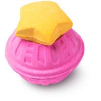 bomba de banho rosa com tampa laranja em forma de estrela